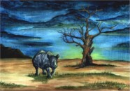 Rhinoceros and tree on African plain at Dawn